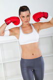 Boxer. A female young boxer woman wearing red boxing gloves Stock Image