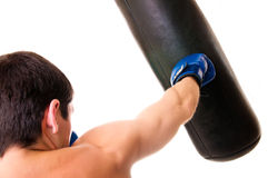 Boxer. In the gym working on the heavy bag throwing a right cross Royalty Free Stock Image