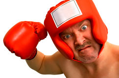 Boxer. A boxer wants to punch someone or something about something. A caption could be inserted on the boxer's headgear front label stock images