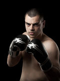 Boxer. Young age handsome man over black background Royalty Free Stock Images