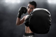 Boxer with black boxing gloves stock images