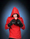 Boxer in black gloves Stock Images