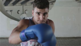 Boxer in blue gloves strikes female cell. Train fast beats. stock footage