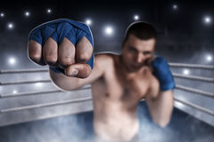 Boxer in blue wrist wraps on the training. Stock Image