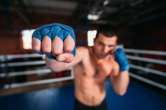 Boxer in blue wrist wraps on the training. Royalty Free Stock Image