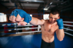 Boxer in blue wrist wraps on the training. Royalty Free Stock Images
