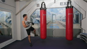Boxer on boxing pear. Training a boxer at the gym stock footage