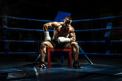 Boxer on boxing ring, tired time-out Stock Photography