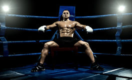 Boxer on boxing ring, tired time-out Royalty Free Stock Photo