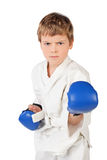 Boxer boy in white and blue boxing gloves fighting Stock Image