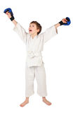 Boxer boy in white dress and blue boxing gloves Royalty Free Stock Photography