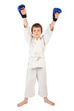 Boxer boy in white dress and blue boxing gloves Royalty Free Stock Images