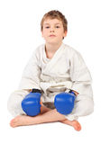 Boxer boy in white dress and blue boxing gloves Stock Photos