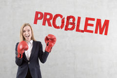 Boxer businesswoman solving problems Royalty Free Stock Image