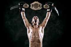 Boxer with Champion belt celebrating flawless victory isolated on black background with copy Space.. Stock Images