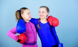 Boxer children in boxing gloves. Confident teens. Female boxers. Boxing provide strict discipline. Competitors on ring. And friends in life. Girls cute boxers royalty free stock images