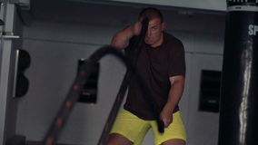 Boxer doing exercise in the gym. Look through the net. Slow motion stock video footage