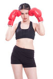 Boxer - fitness woman boxing wearing boxing gloves Royalty Free Stock Images