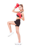 Boxer - fitness woman boxing wearing boxing red gloves Stock Image