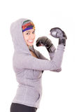 Boxer - fitness woman wearing boxing gloves. Royalty Free Stock Images