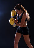 Boxer. Fitness woman wearing yellow boxing gloves Royalty Free Stock Photos