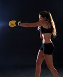 Boxer. Fitness woman wearing yellow boxing gloves Royalty Free Stock Images