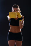 Boxer. Fitness woman wearing yellow boxing gloves Stock Image