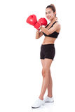 Boxer - Full length fitness woman boxing wearing boxing red gloves Royalty Free Stock Image