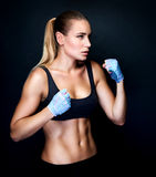 Boxer girl in action Stock Photos