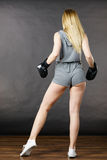 Boxer girl exercise with boxing gloves. Stock Photos