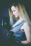 Boxer girl exercise with boxing gloves. Royalty Free Stock Photography