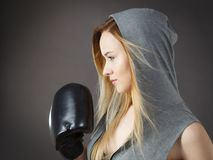 Boxer girl exercise with boxing gloves stock photos