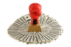 Boxer glove and dollars. Royalty Free Stock Photo