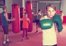 Boxer in gloves posing during boxing explaining Stock Photo