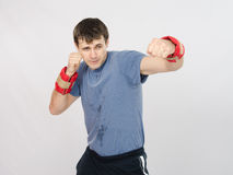 Boxer has a left hand with the weighting agent Royalty Free Stock Photo