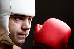 Boxer in helmet and boxing gloves Stock Photos