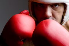 Boxer in helmet and boxing gloves close up Royalty Free Stock Photos
