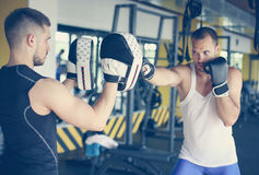 Boxer hitting the glove of his sparring partner. Royalty Free Stock Image