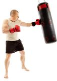 Boxer hitting the punching bag Royalty Free Stock Photography