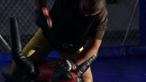 Boxer hitting punching boxing bag- mannikin in the gym stock video footage