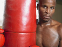 Boxer Holding Punching Bag Stock Photos