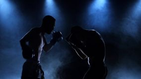 Boxer holding a series of exact blows on the opponent stock video footage