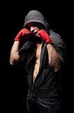 Boxer in hood over black background royalty free stock photo