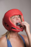 Boxer inserting a gum shield into the mouth Royalty Free Stock Image