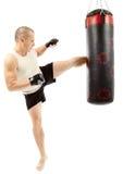 Boxer kicking the punching bag Royalty Free Stock Images