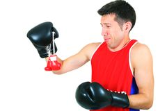 Boxer looks at small gloves Royalty Free Stock Photo