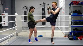 Boxer man doing warm up exercise together sport trainer in gym club. Personal coach training kickboxer man in fight club. Boxing training. Sport lifestyle stock video