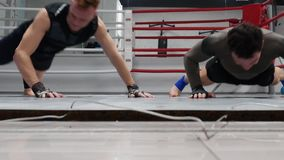Boxer man training push ups exercises and clapping hands in gym. Fighters doing push up exercise while split training o. N ring in fight club. Active lifestyle stock footage