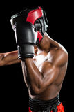 Boxer performing upright stance. On black background Royalty Free Stock Photography