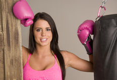 Boxer pink boxing gloves heavy punching bag Royalty Free Stock Image